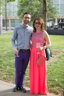 I love this couple's outfits. I must find out where he bought those purple pants! Isn't her dress adorable?