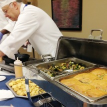 Elleword - This chef is laying out scallops near the roasted brussels sprouts and turkey pot pie.